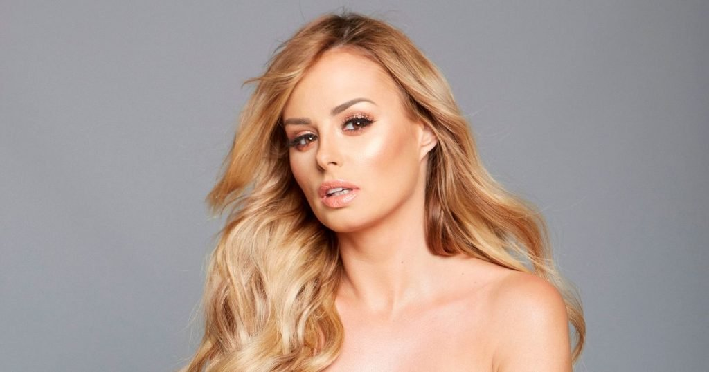 Rhian Sugden flaunts flawless figure in topless snaps to